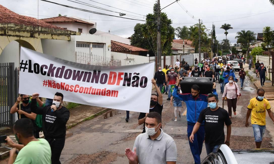 Manifestação contra fechamento do comércio no Distrito Federal Foto: Evaristo Sá/AFP