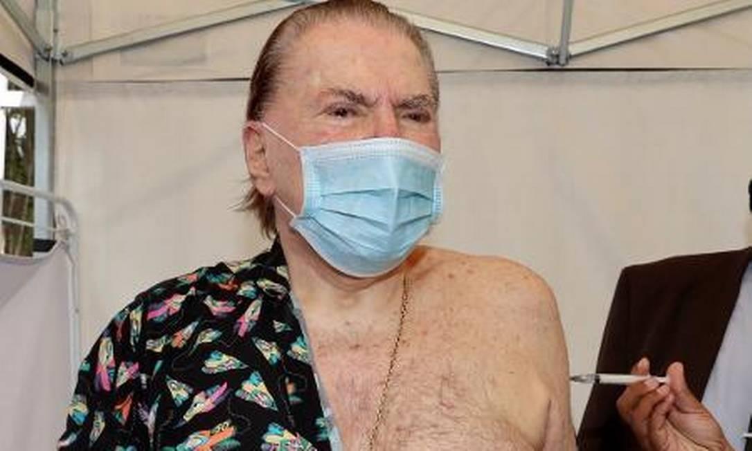 O apresentador Silvio Santos, de 90 anos, foi vacinado contra a Covid-19 nesta quarta-feira (10), em um posto de vacinação da Prefeitura de São Paulo, na Zona Sul da capital Foto: Reprodução