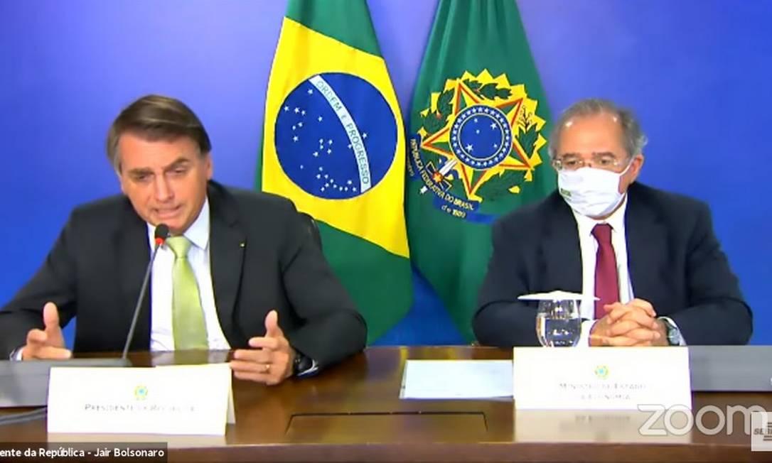 O presidente Jair Bolsonaro participa de reunião ao lado do ministro da Economia, Paulo Guedes Foto: Reprodução/Youtube