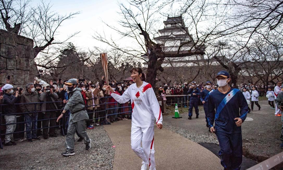 Revezamento da tocha foi cancelado nas ruas de Tóquio Foto: PHILIP FONG / AFP