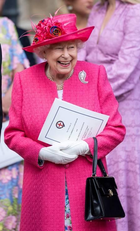 O rosa tem lugar cativo no guarda-roupa da rainha Foto: Getty Images
