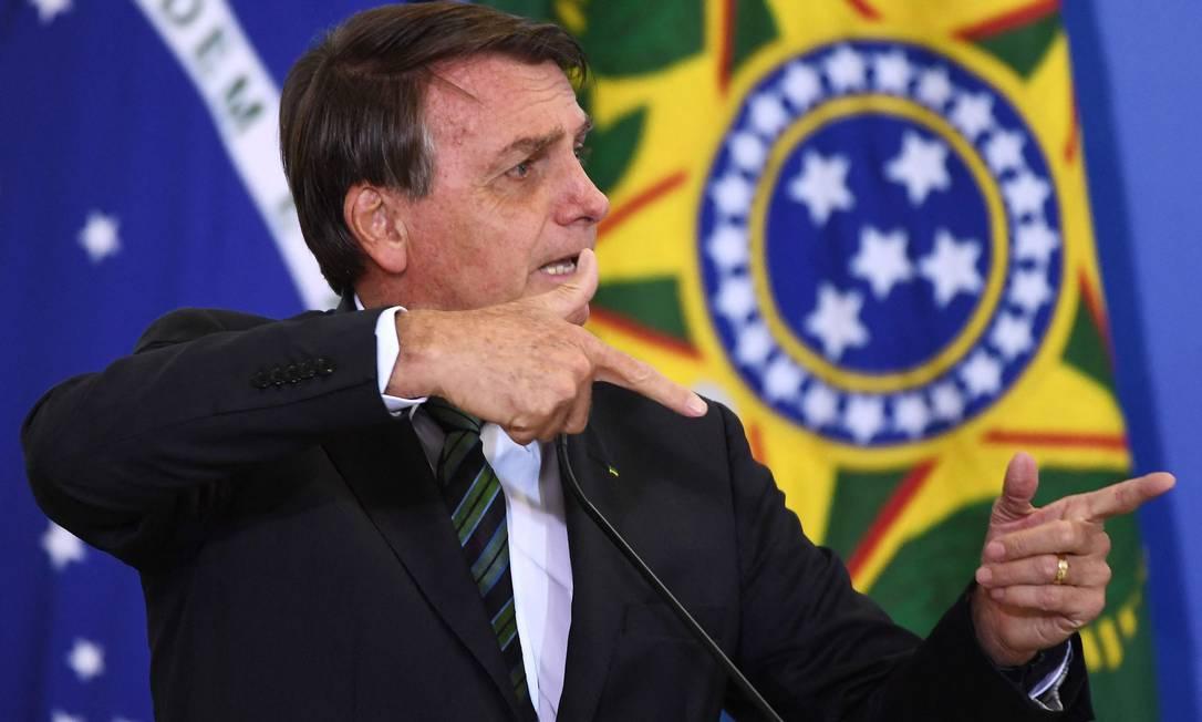 Reportagem comparou postura 'anticientífica' de Bolsonaro ao do ex-presidente americano Donald Trump Foto: EVARISTO SA/AFP/9-2-2021