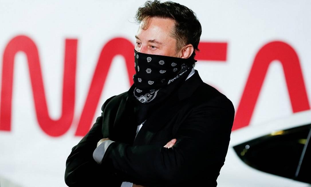 Musk: aposta em criptomoedas na Tesla e na SpaceX Foto: JOE SKIPPER / REUTERS