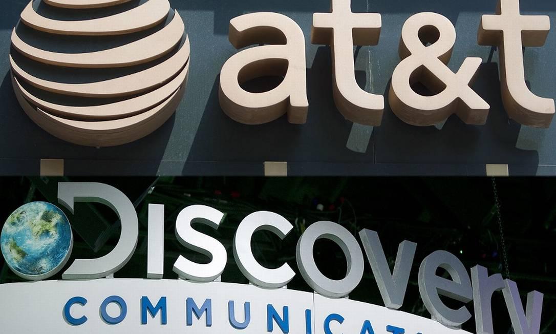 Logotipos de AT&T e Discovery: nova tática com fusão Foto: Bloomberg / Photographer: Bloomberg/Bloomber