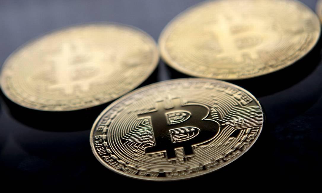 Bitcoin: tombo vertiginoso nos mercados Foto: JUSTIN TALLIS / AFP