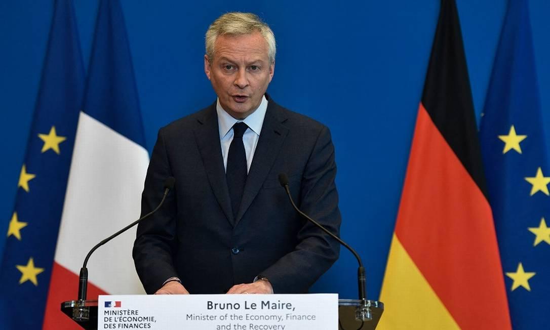 Bruno Le Maire, ministro da Economia da França, em videoconferência com seu colega alemã: países europeus querem regras mais duras para aquisições feitas pelas big techs Foto: STEPHANE DE SAKUTIN / AFP