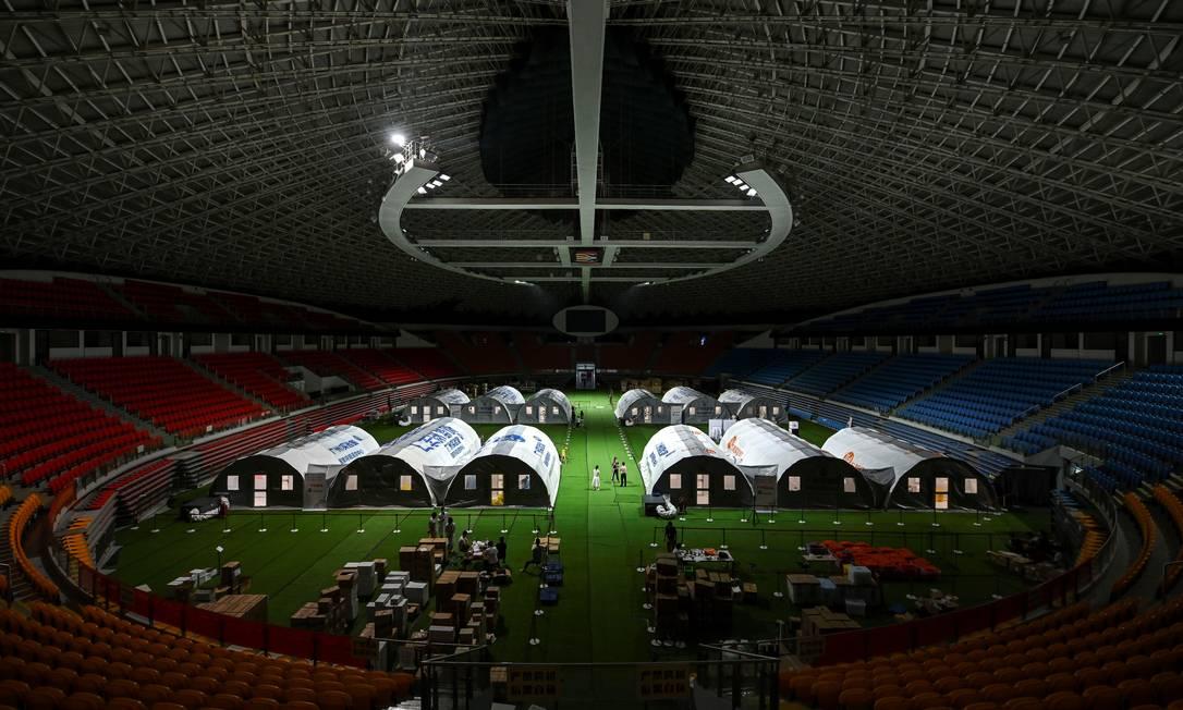Centros móveis de testagem são vistos no ginásio municipal de Guangzhou, província de Guangdong, China Foto: STRINGER / VIA REUTERS/03-06-2021