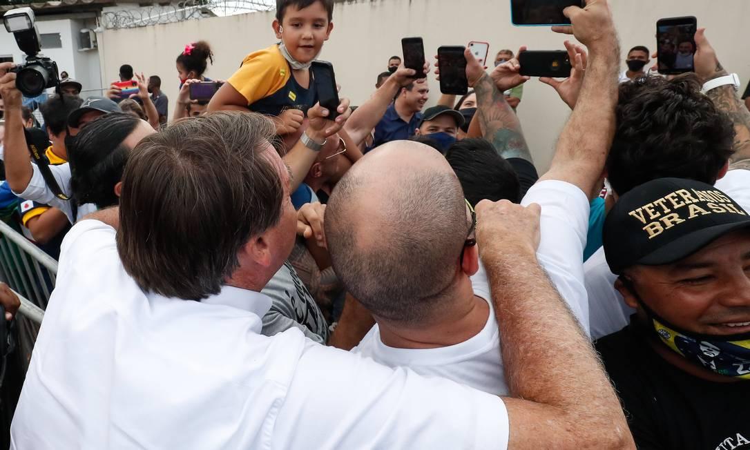 Bolsonaro faz parada não programada em Cruzeiro dos Peixotos, distrito de Uberlândia, Minas Gerais Foto: Alan Santos / PR - 04/03/2021