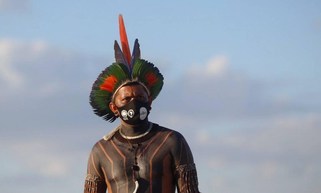 Homem indígena participa de protesto contra o PL 490 em Brasília Foto: ADRIANO MACHADO / REUTERS/24-6-21