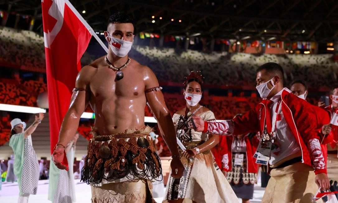 Os porta-bandeiras de Tonga, Pita Taufatofua e Malia Paseka Foto: ODD ANDERSEN / AFP