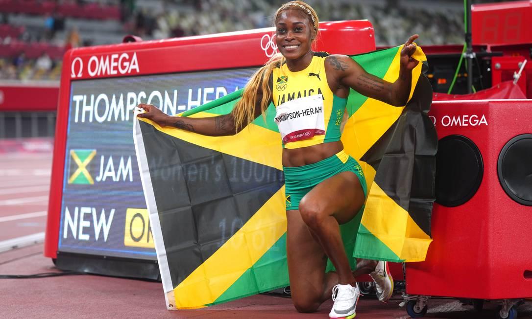 Elaine Thompson-Herahcelebra a medalha de ouro e o novo recorde olímpico dos 100 metros rasos Foto: ALEKSANDRA SZMIGIEL / REUTERS