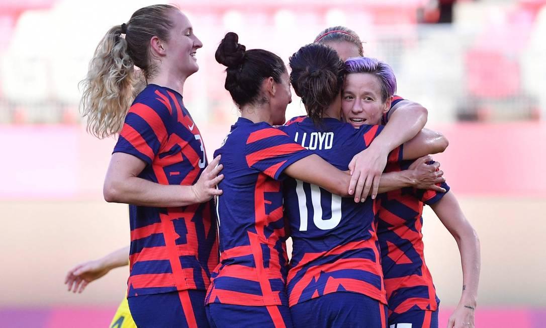 Federação de futebol dos EUA apresenta contratos de trabalho iguais para os times feminino e masculino Foto: TIZIANA FABI / AFP