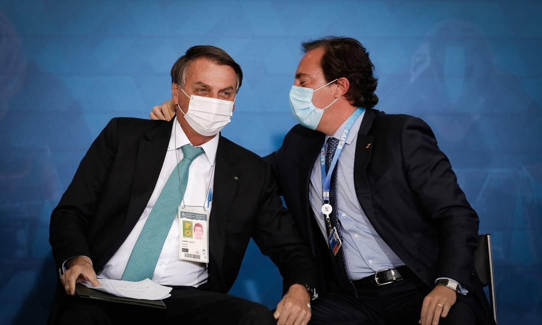 O presidente da Caixa, Pedro Guimarães, ao lado do presidente Jair Bolsonaro Foto: Pablo Jacob / Agência O Globo