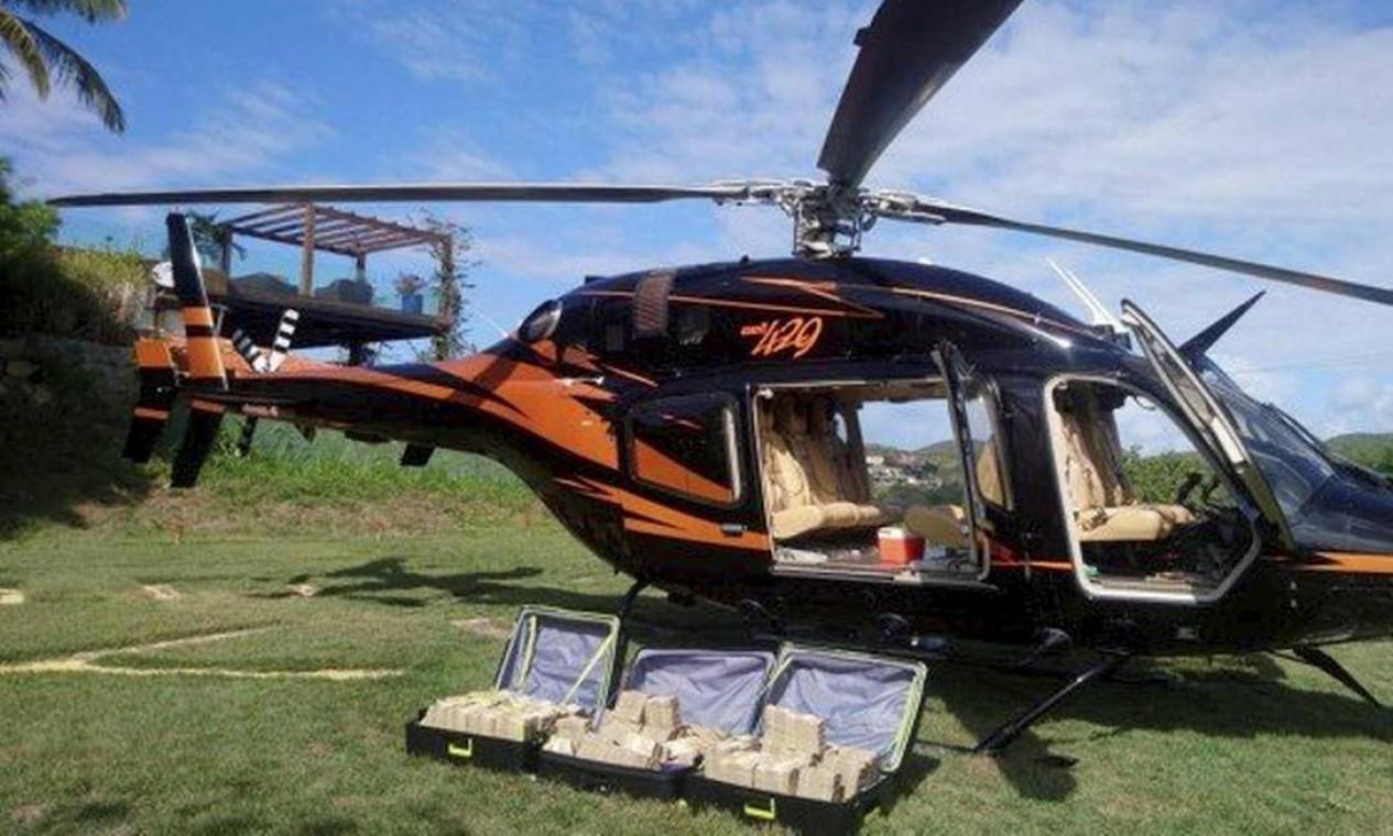 Polícia Federal afirma que os R$ 7 milhões encontrados em helicóptero, em Búzios, eram de Glaidson Acácio e oriundo de lavagem de dinheiro. Montante estava escondido em três malas e seria levado para São Paulo Foto: Agência O Globo