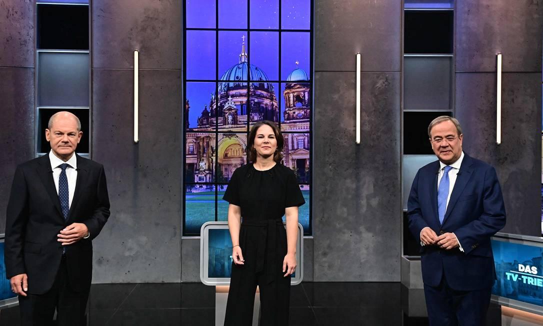 Os três principais candidatos alemães: Olaf Scholz (à esquerda), Annalena Baerbock e Armin Laschet, da coalizão CDU/CSU Foto: TOBIAS SCHWARZ / AFP