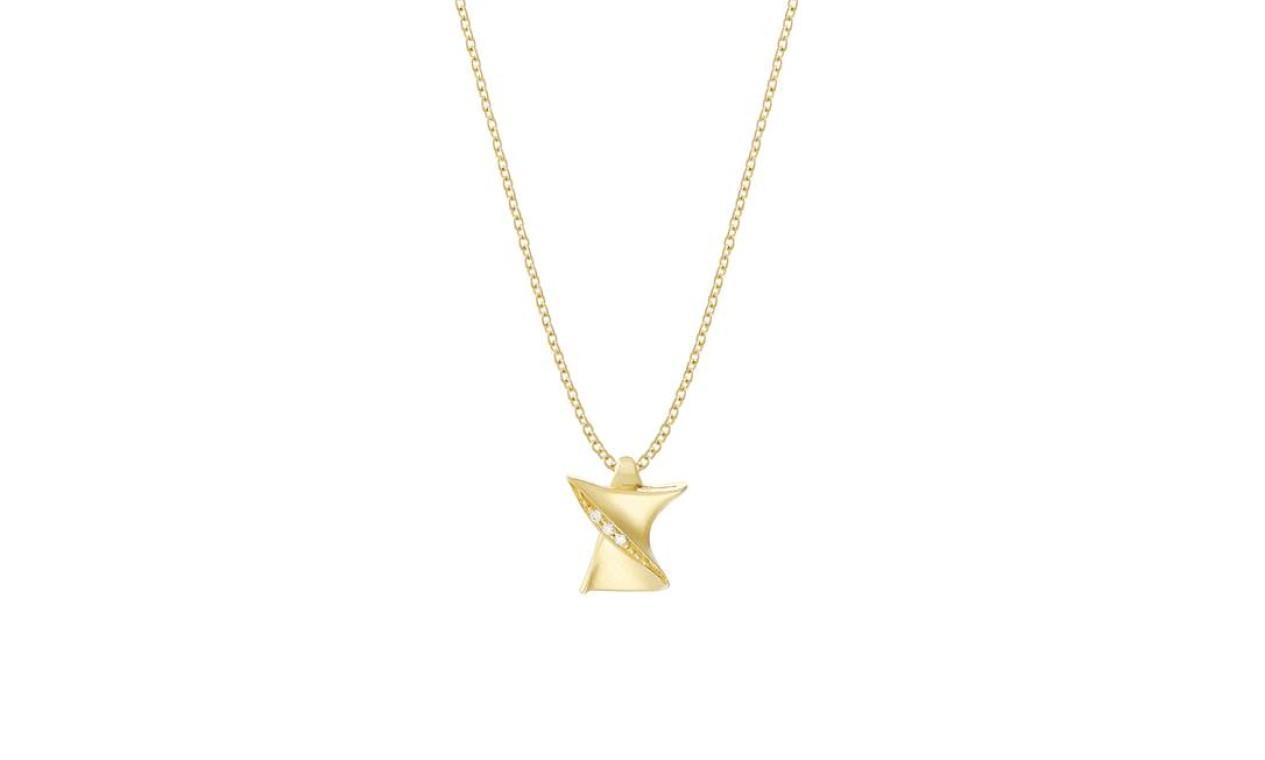 Joia sagrada: o abraço do Cristo foi reproduzido no pequeno pingente em ouro amarelo 18 quilates e diamantes, vendido ao preço de R$ 2.070