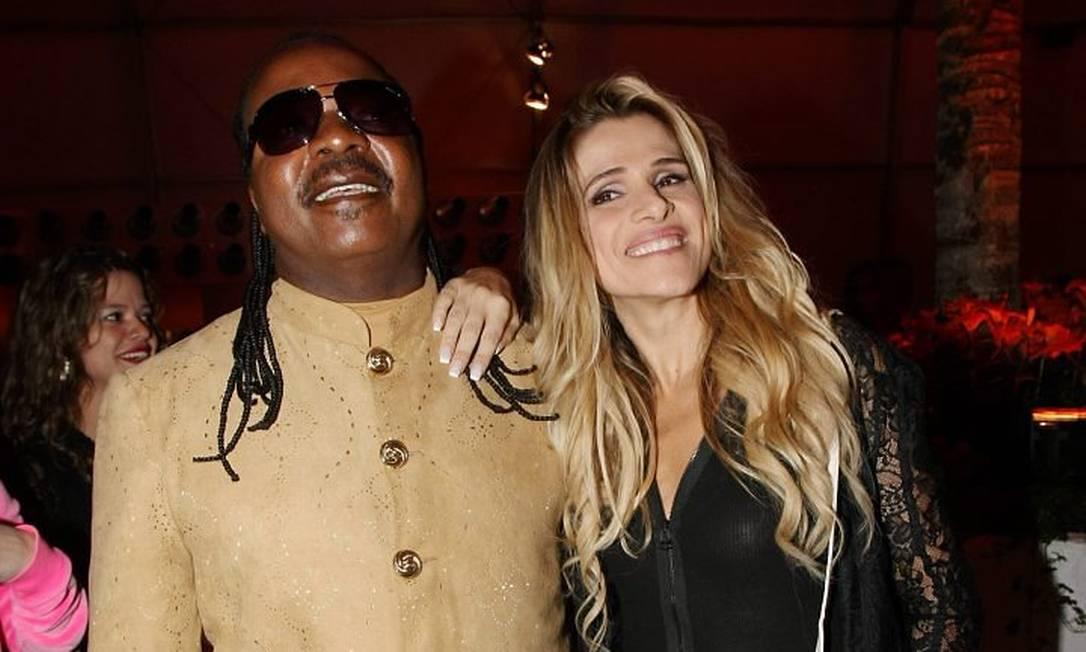 O sósia de Stevie Wonder e a atriz Ingrid Guimarães na área vip do Rock in Rio Marcos Ramos