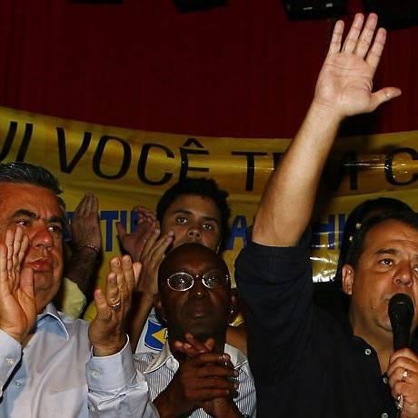 SÉRGIO CABRAL na convenção do PTC com Jorge Picciani (à esquerda) e no lançamento de pedra fundamental com Eduardo Paes, em Santa Cruz Foto de André Teixeira - O Globo