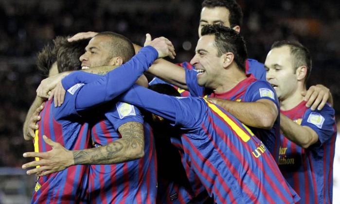 Jogadores do Barcelona comemoram a vitória sobre o Santos na final do Mundial de Clubes Hiro Komae / AP