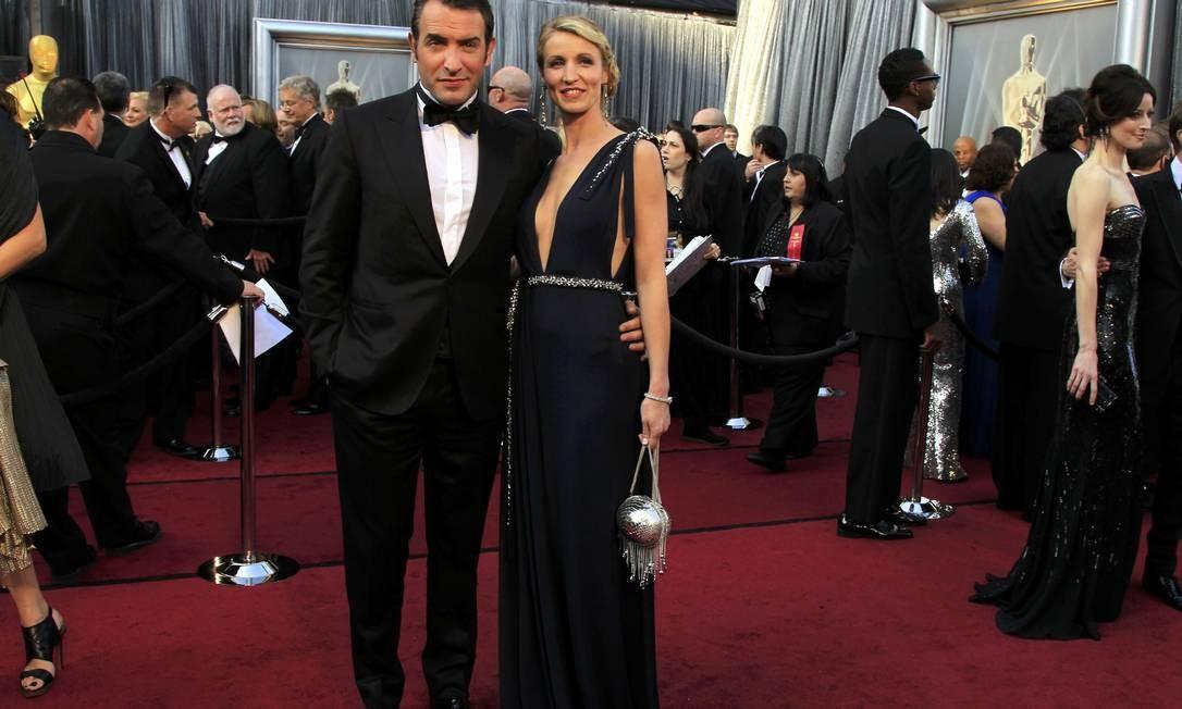 O ator francês Jean Dujardin marcou presença acompanhado de sua esposa Alexandra Lamy Foto: Reuters/Divulgação