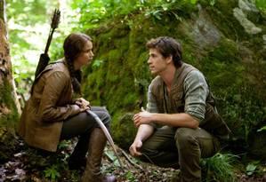 Os atores Jennifer Laurence e Liam Hemsworth em cena do filme 'Jogos Vorazes' Foto: Divulgação