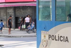 Na Cidade de Deus, lojistas, com medo, fecham as portas mesmo com a presença de uma cabine da PM Foto: Guilherme Pinto / Extra/O Globo