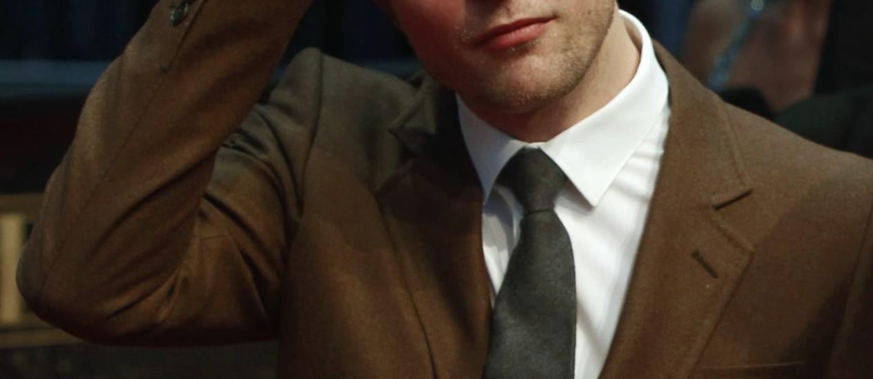 O ator Robert Pattinson quer fastar a imagem do vampiro da saga 'Crepúsculo' Foto: THOMAS PETER / Reuters