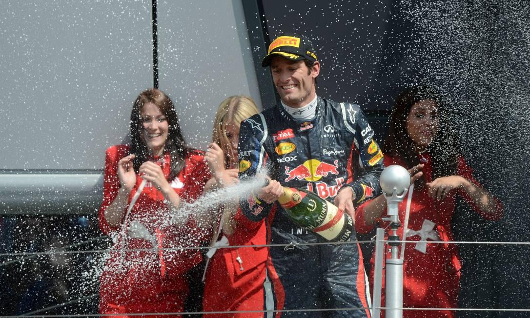 Webber ultrapassa Alonso e vence o GP da Inglaterra Foto: DIMITAR DILKOFF / AFP