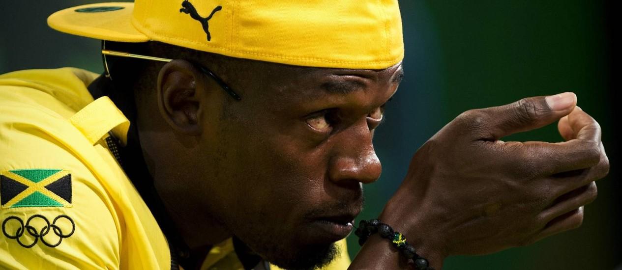 Velocista Usain Bolt durante entrevista coletiva em Londres Foto: Adrian Dennis / AFP Photo