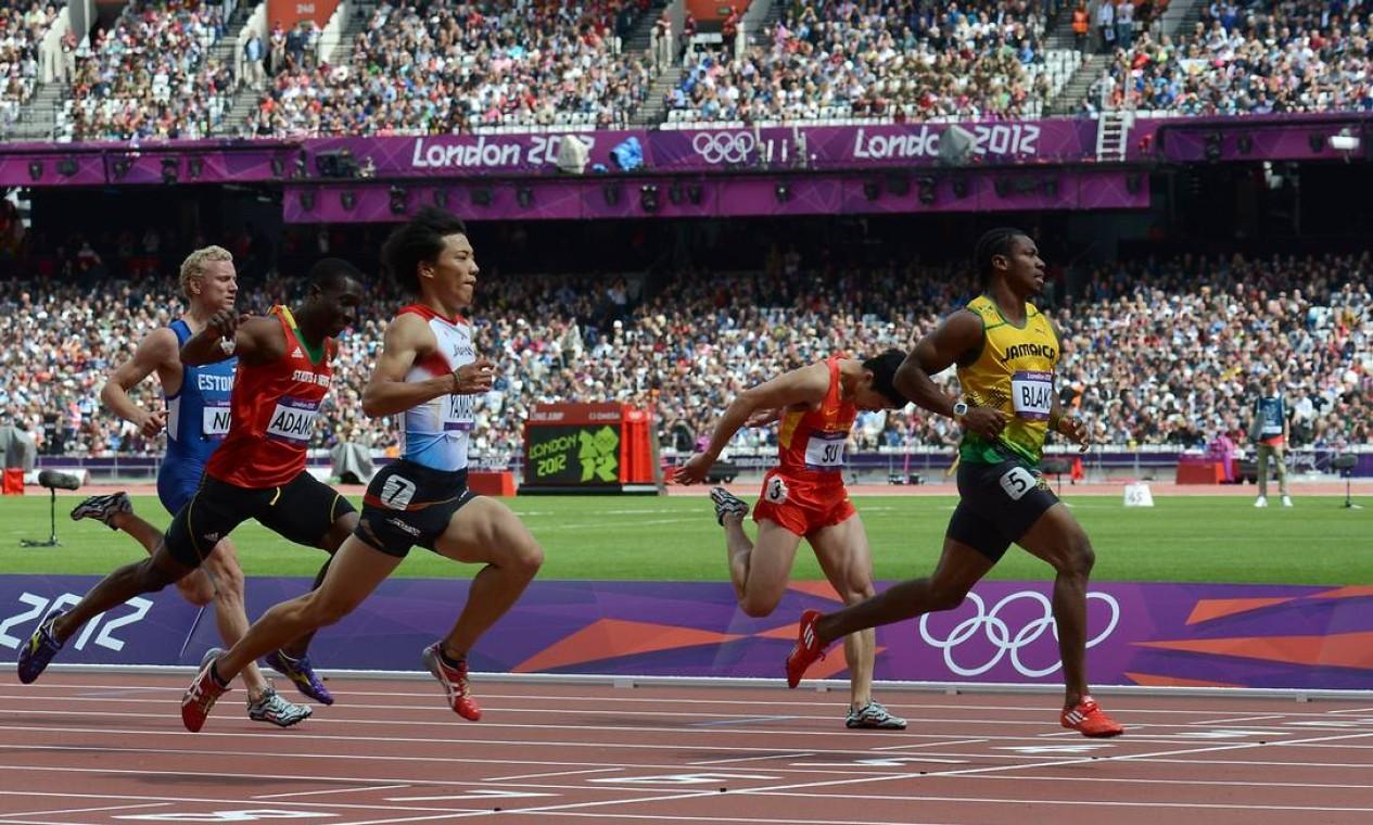 Johan Blake vence com tranquilidade sua classificatória nos 100m rasos Foto: AFP Photo