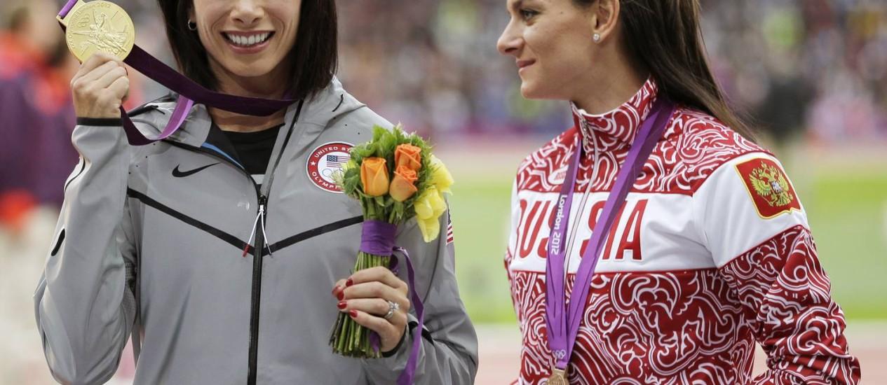Isinbayeva de olho no ouro conquistado pela americana Jennifer Suhr Foto: Matt Slocum / AP Photo