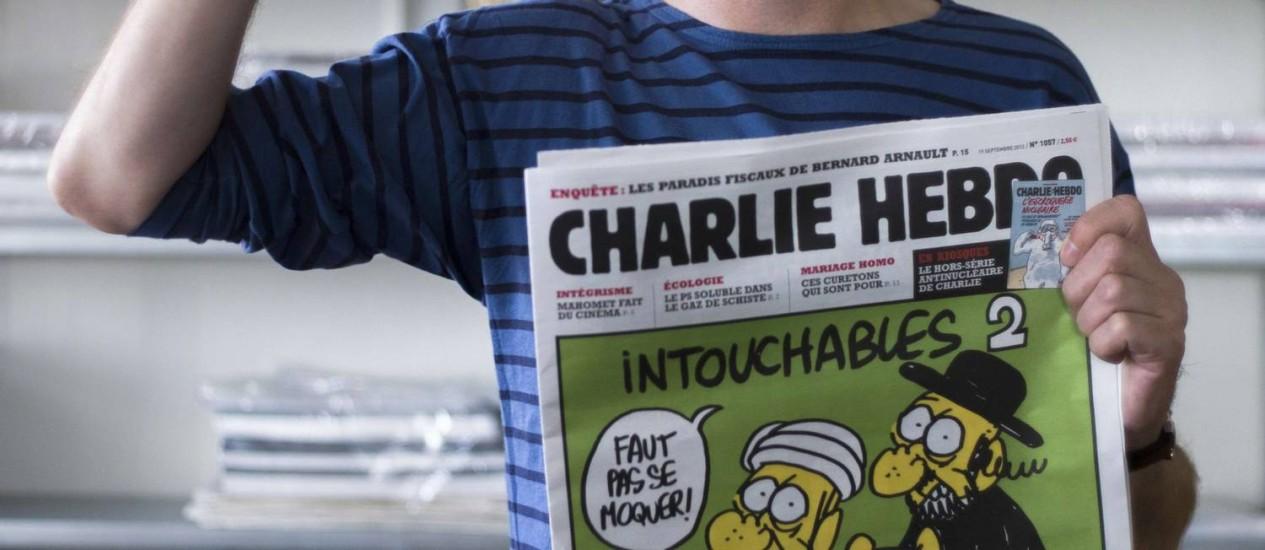 Identificado apenas como Charb, o responsável pela publicação alega defesa da liberdade de expressão Foto: Fred Dufour/AFP