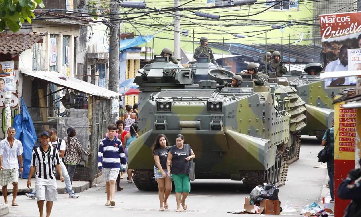 Concluída em 20 minutos, a entrada dos policiais na favela foi tranquila e sem confrontos com traficantes Foto: Foto Pablo Jacob/ Agência O Globo
