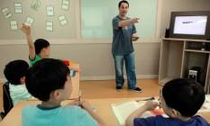 Aula de inglês para crianças na Coreia do Sul: o país é visto como um modelo na área de educação Foto: Seokyong Lee/Bloomberg News