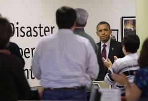 Obama é aplaudido durante visita ao quartel-general da Cruz Vermelha Foto: AP/Pablo Martinez Monsivais