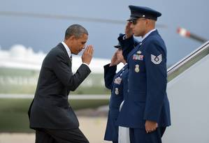 Obama embarca no Air Force One nesta quinta-feira Foto: JEWEL SAMAD / AFP