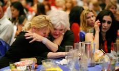 Lágrimas conservadoras. Em Las Vegas, eleitoras republicanas choram após o anúncio da reeleição de Barack Obama Foto: David Becker/Getty Images/AFP