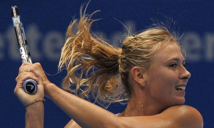 Sharapova ganhou o segundo set com mais dificuldade: 7 a 4 no tie-break YASUYOSHI CHIBA / AFP