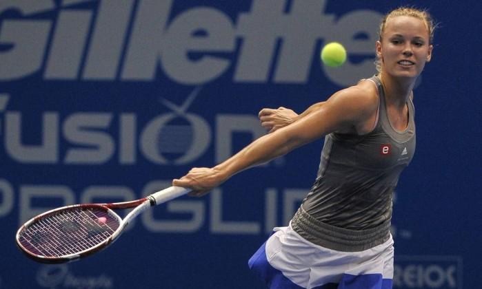 Jogando para valer, a dinamarquesa, décima do ranking da WTA, não conseguiu bater a rival YASUYOSHI CHIBA / AFP