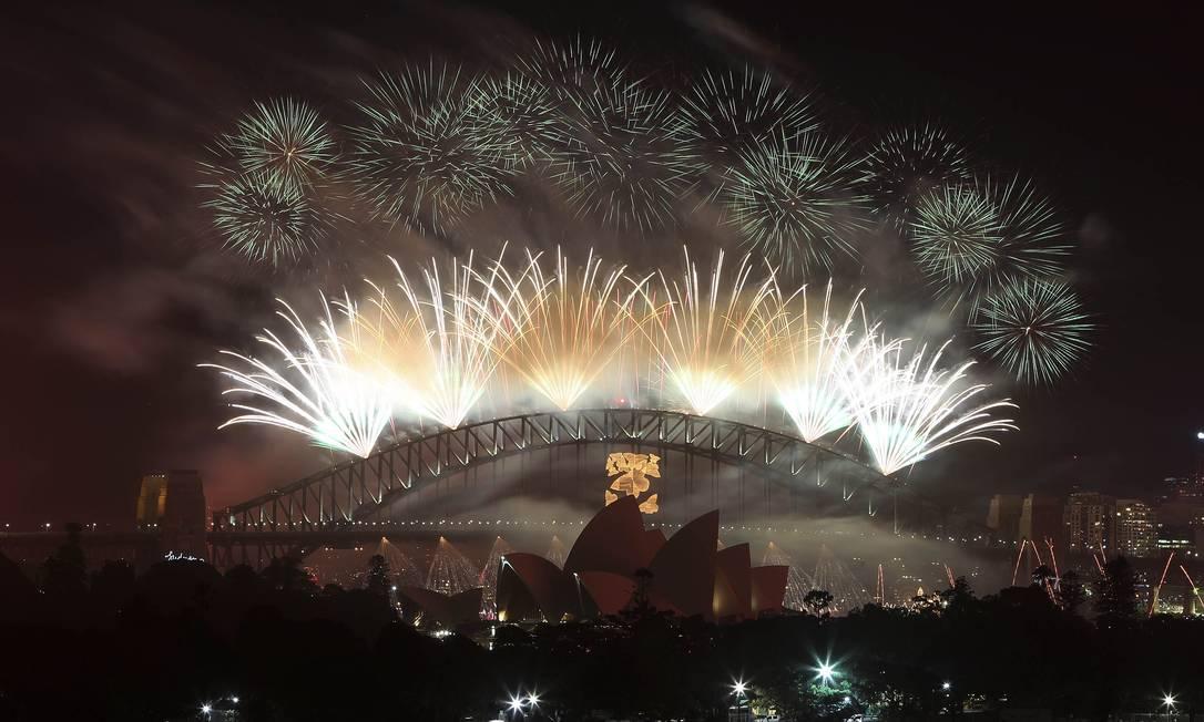 Em Sydney, na Austrália, réveillon chega 13 horas antes do Ano Novo carioca Rob Griffith / AP