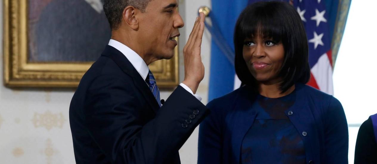 Ao lado de Michelle, Obama faz juramento de seu segundo mandato na Casa Branca Foto: AFP