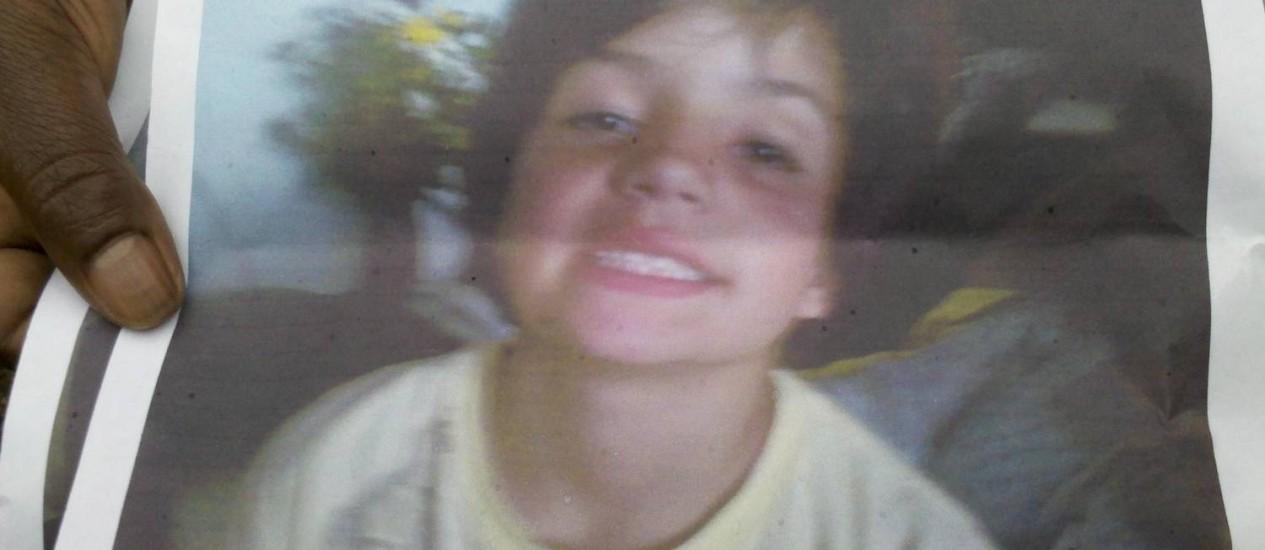 Menino Nicolás, de 8 anos, está desaparecido após o temporal Foto: Álbum de família / Reprodução