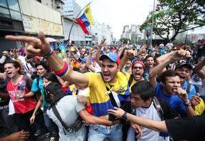 Em marcha, opositores foram atacados por membros do Tupamaro Foto: Fernando LLano / AP