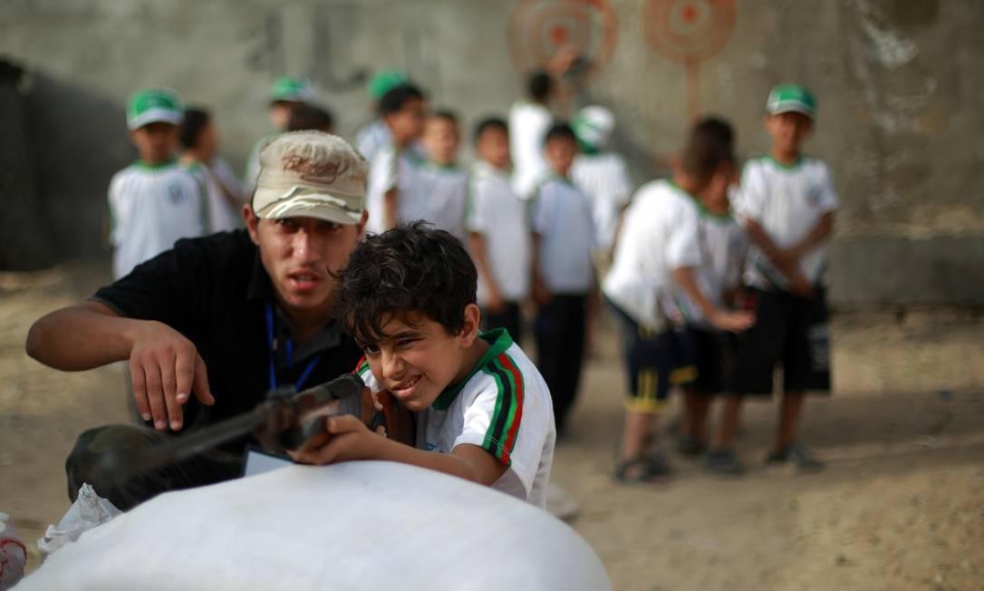 A colônia de férias do Hamas é gratuita. Ela é custeada por uma série de fontes, como doações do mundo muçulmano e receitas locais, tais como impostos Foto: MOHAMMED ABED / AFP