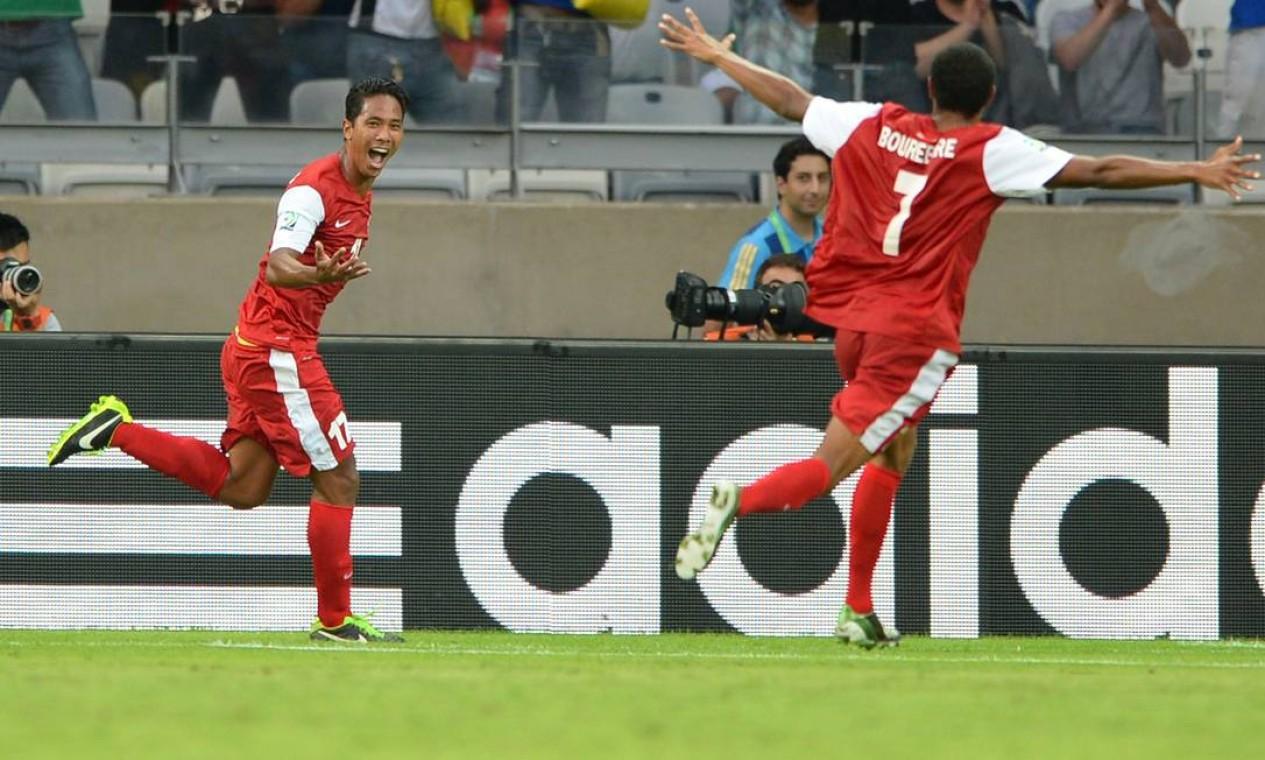 Aos sete minutos do segundo tempo, Jonathan Tehau marcou o primeiro gol do Taiti Foto: EITAN ABRAMOVICH / AFP