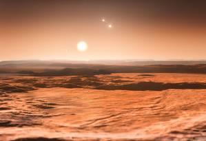 Ilustração do ESO mostra como seria a visão do céu de uma das novas três 'super-Terras' detectadas em órbita na zona habitável da estrela Gliese 667C, mostrando ao fundo suas companheiras Gliese 667A e Gliese 667B) e um dos novos planetas, Gliese 667Ce, como um astro em fase crescente Foto: ESO/M. Kornmesser