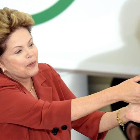 Dilma Rousseff durante cerimônia sobre o programa 'Mais Médicos' Foto: EVARISTO SA / AFP