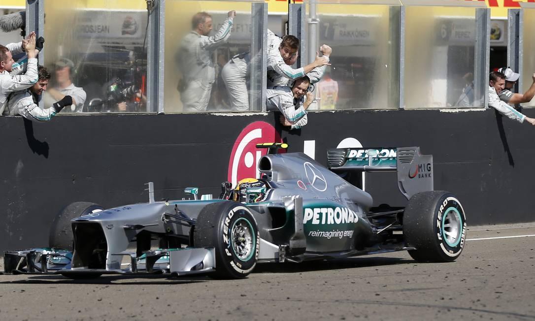 Mercedes driver Lewis Hamilton of Britain celebrates with his teammates after winning the Hungarian Formula One race at the Hungaroring racetrack near Budapest, Hungary, Sunday, July 28, 2013. (AP Photo/Petr David Josek) Petr David Josek / AP