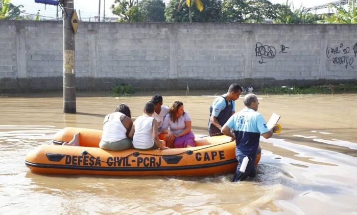 Famílias precisaram ser resgatadas Pablo Jacob / Agência O Globo