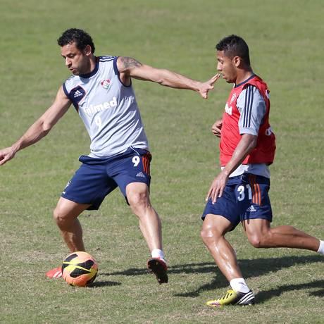 Fred e Samuel no treino do Fluminense nas Laranjeiras Foto: Ivo Gonzalez / Agência O Globo